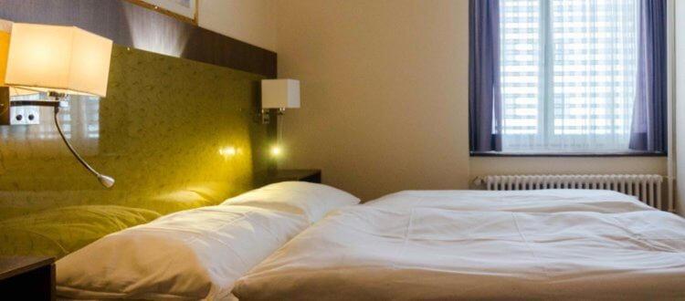 Ein Bett oder Betten in einem Zimmer der Unterkunft Zys Hotel