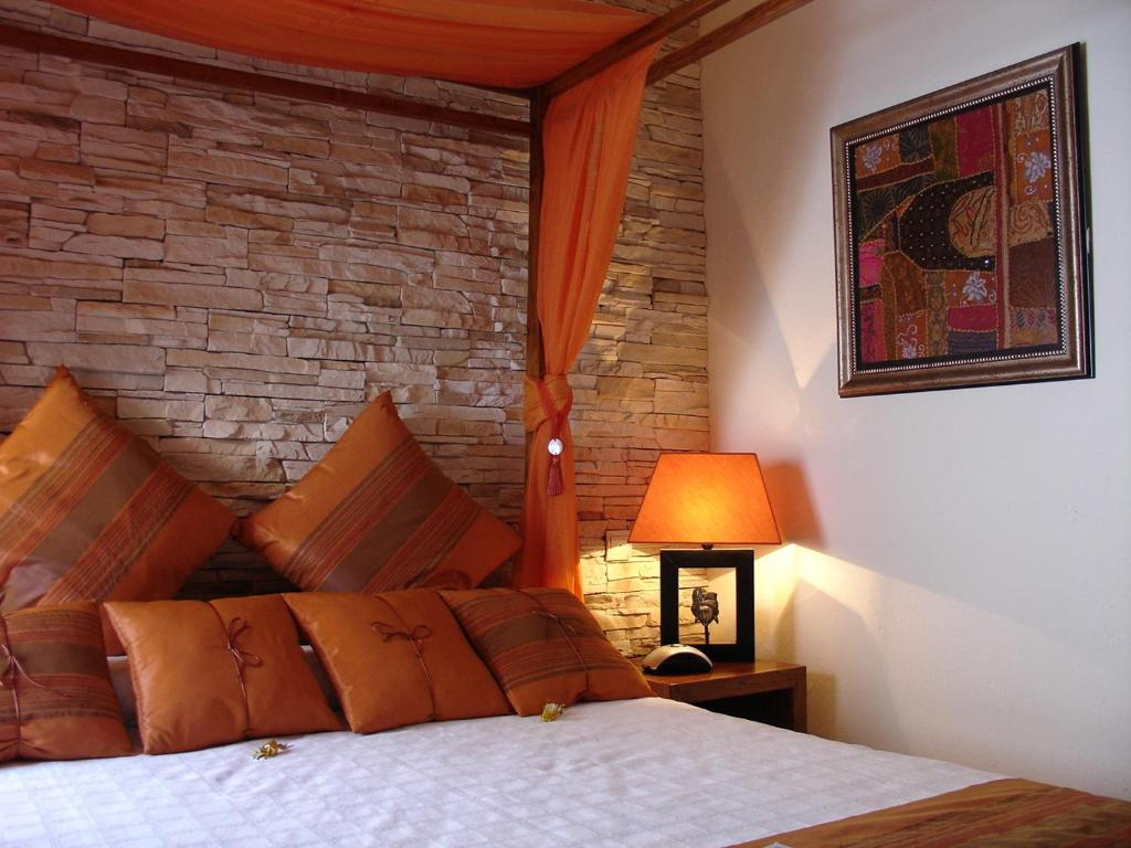A bed or beds in a room at La Villa Marbella - Old Town