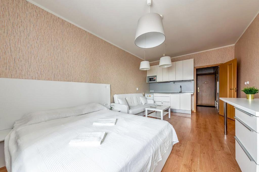 Кровать или кровати в номере Apartment Hanaka Jubileinyi 72