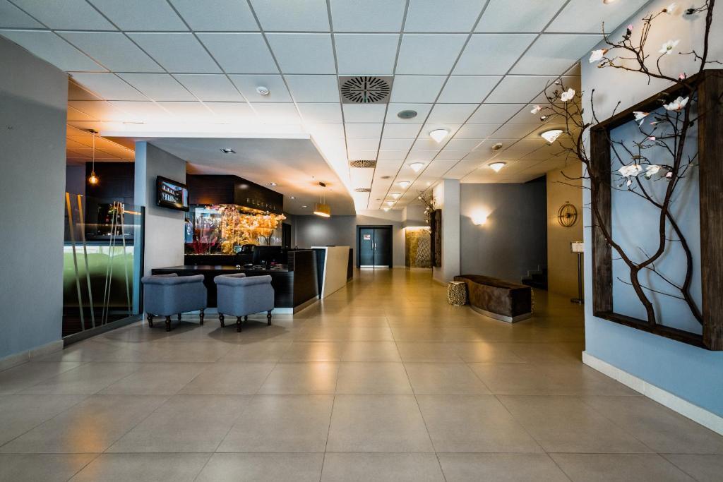 Vstupní hala nebo recepce v ubytování Hotel Palcát