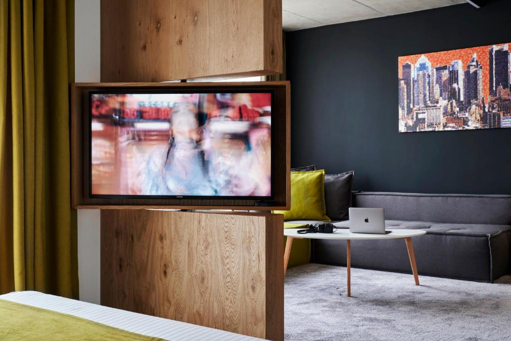 A television and/or entertainment centre at Adella Boutique Hotel