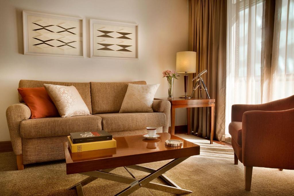 Uma área de estar em Etoile Hotels Itaim