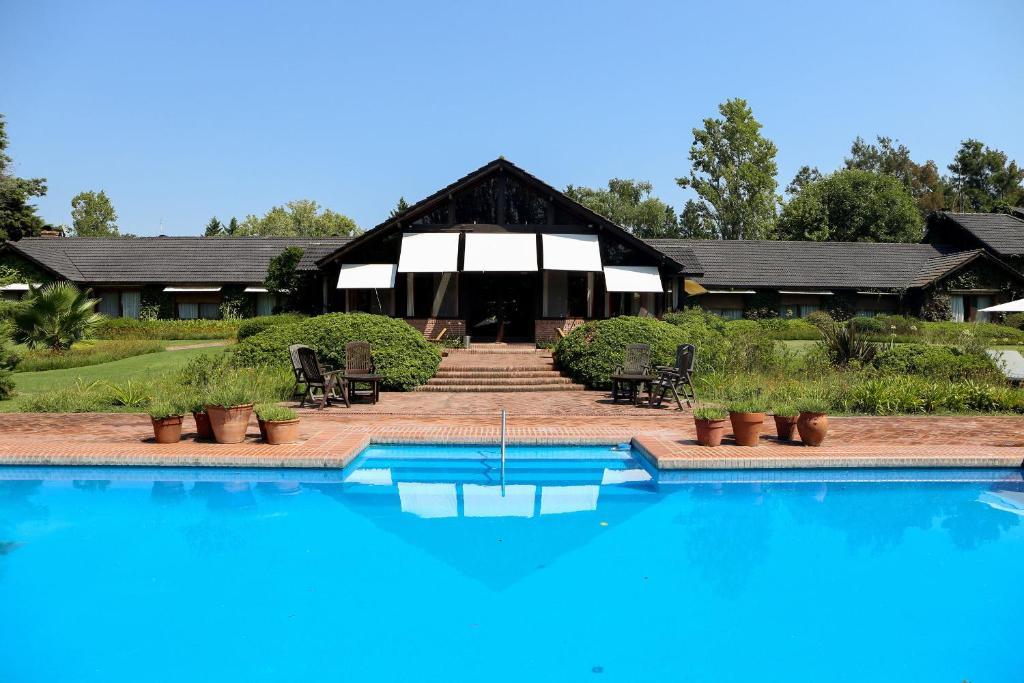 The swimming pool at or near La Posta del Pilar Hotel & Spa