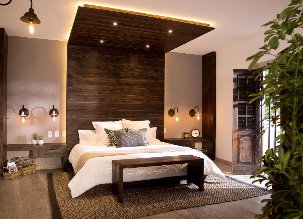 Cama o camas de una habitación en H21 Hotel Boutique