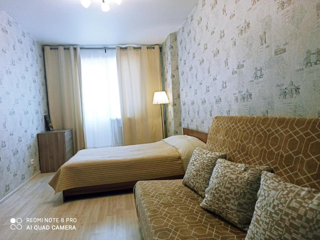 """A bed or beds in a room at Апартаменты""""Like Home"""" на Фрунзе 49"""
