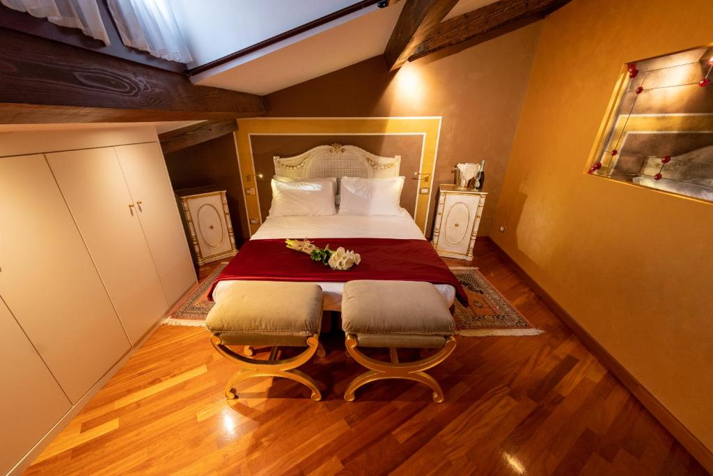 A bed or beds in a room at Cà dell'arte Suite