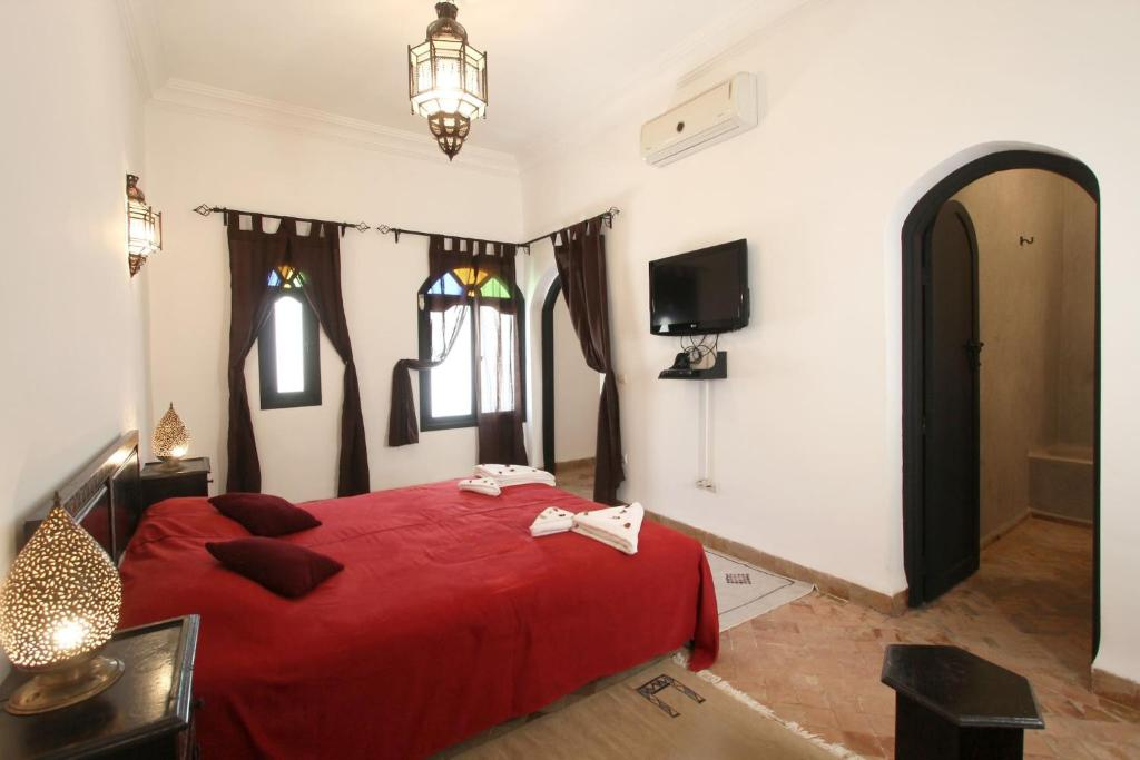 A bed or beds in a room at Riad Dar Foundouk - Superior Room 3