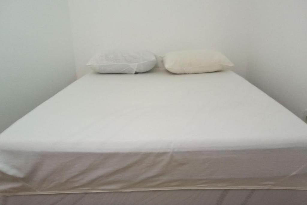 A bed or beds in a room at Pousada Rio de Agua Viva