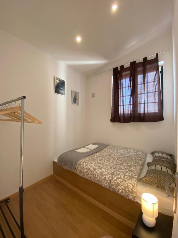 A bed or beds in a room at Casa Vale Apartamentos