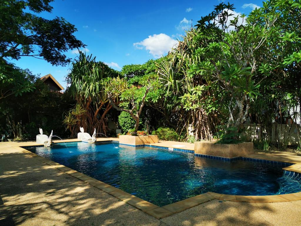 The swimming pool at or near Jasmine Hills Lodge