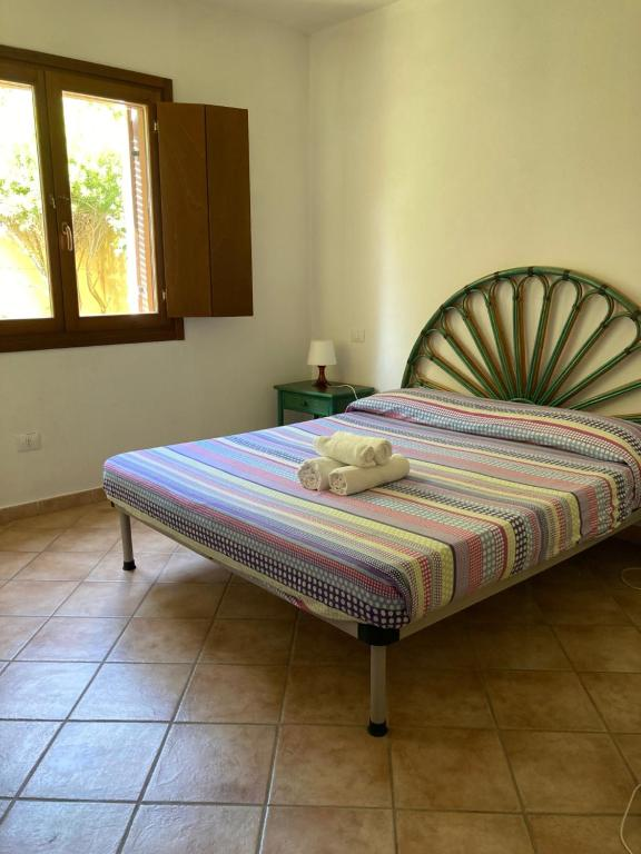 A bed or beds in a room at Residence Olimpo apartments