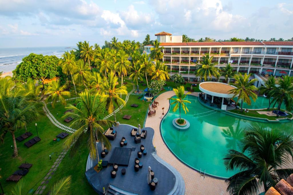 A view of the pool at Occidental Eden Beruwala, a member of Barcelo Hotel Group or nearby