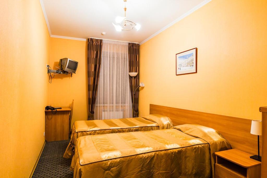 Кровать или кровати в номере Отель Old Flat на Греческом