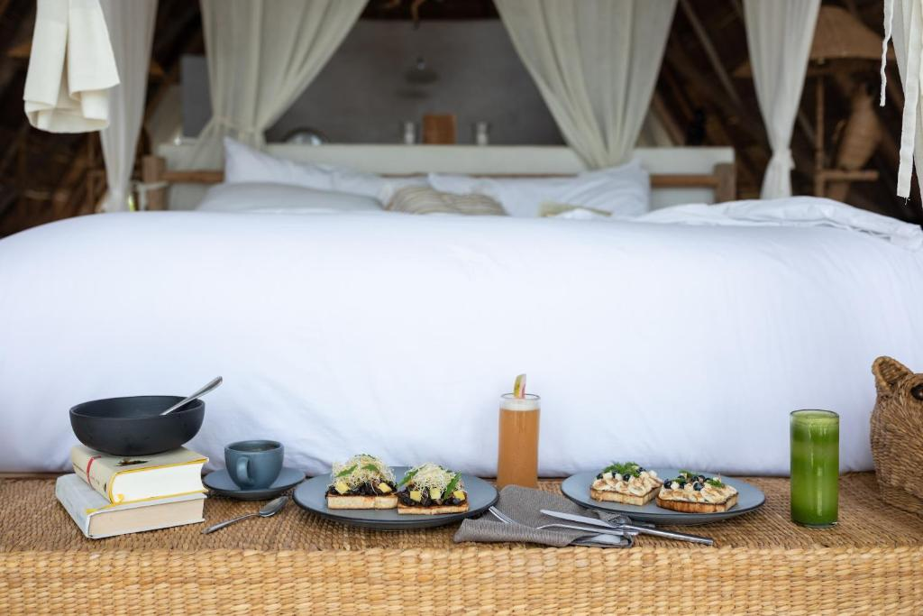 A bed or beds in a room at La Valise Tulum