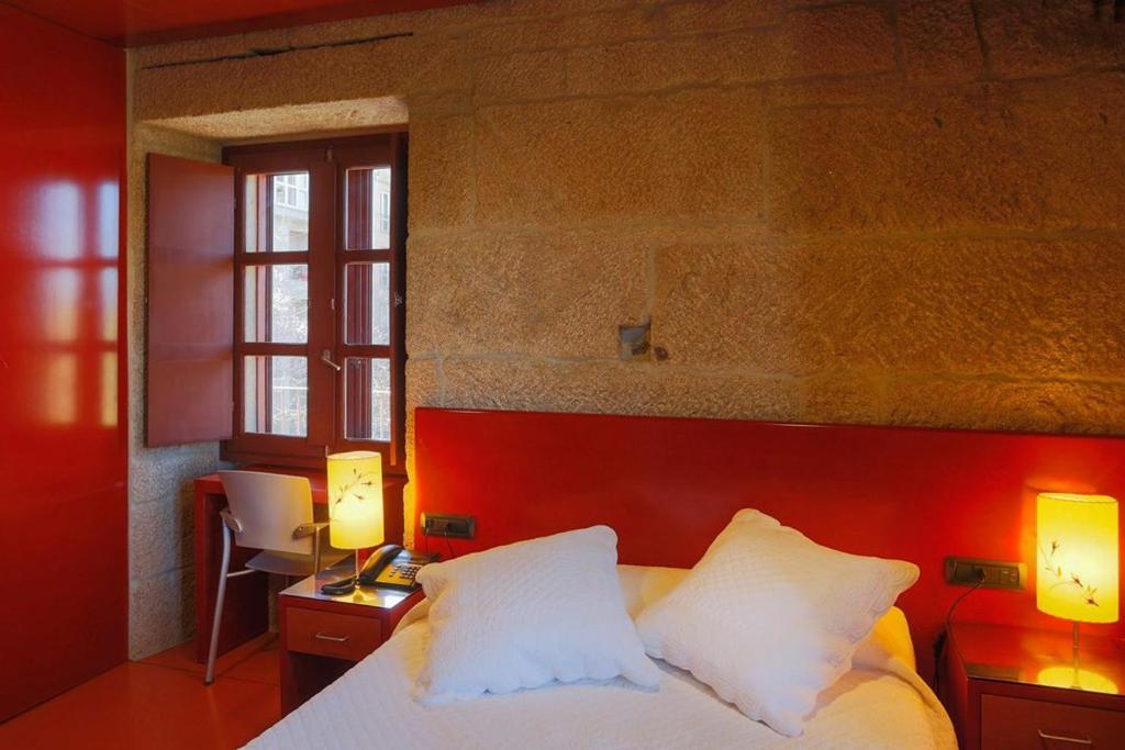 Cama o camas de una habitación en Casa Rural Torre Lombarda