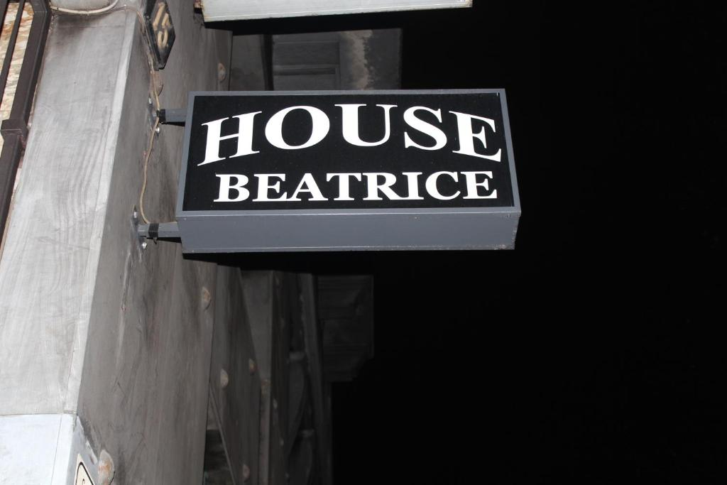 The logo or sign for the guest house