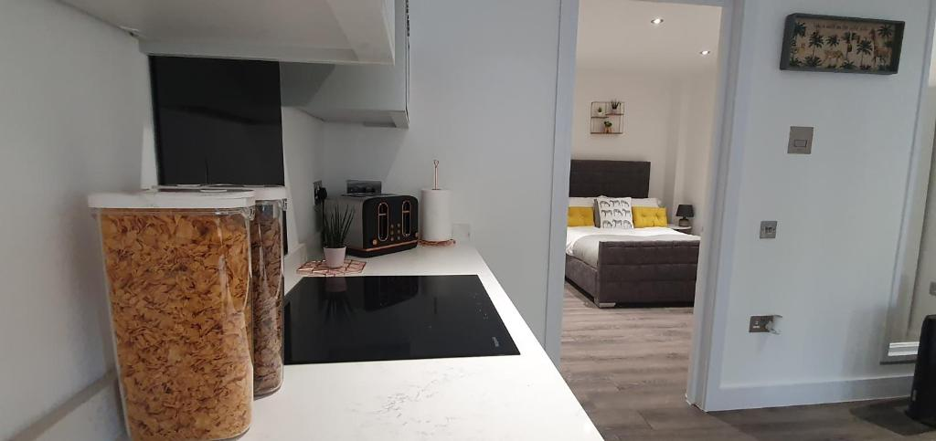 A kitchen or kitchenette at Wildly interesting. 1 bedroom serviced apartment