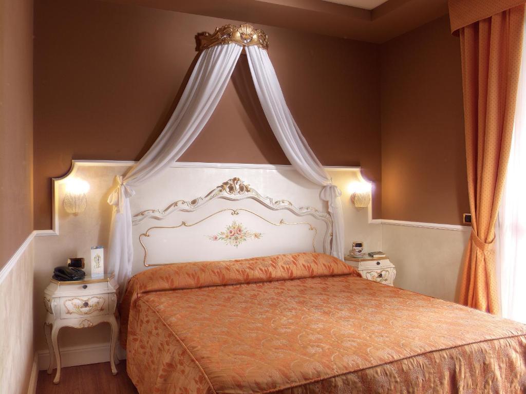 Letto o letti in una camera di Hotel Confine