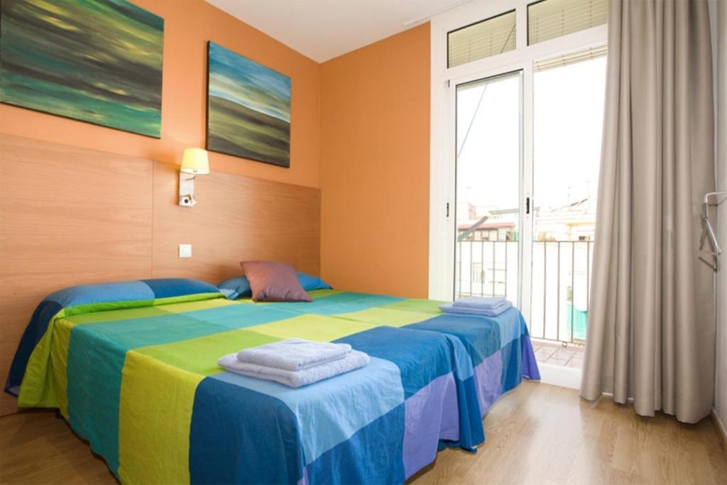 Cama o camas de una habitación en La Fira