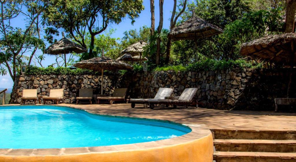 The swimming pool at or near Kigongoni Lodge Arusha