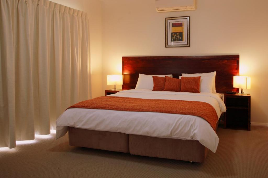 A bed or beds in a room at Talga Estate