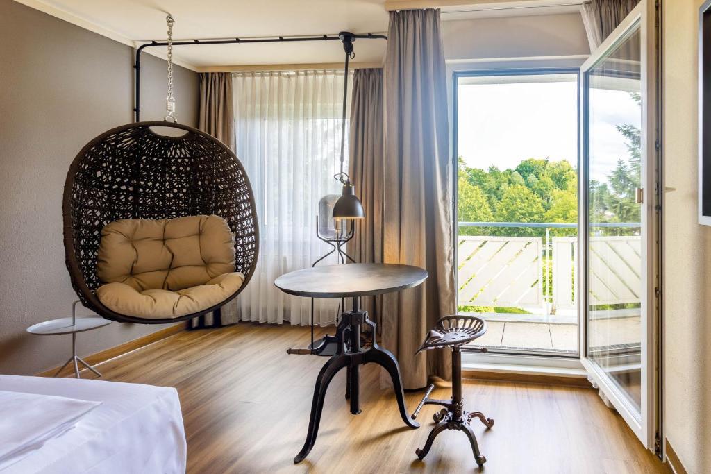 Ein Sitzbereich in der Unterkunft Seminaris Hotel Bad Boll