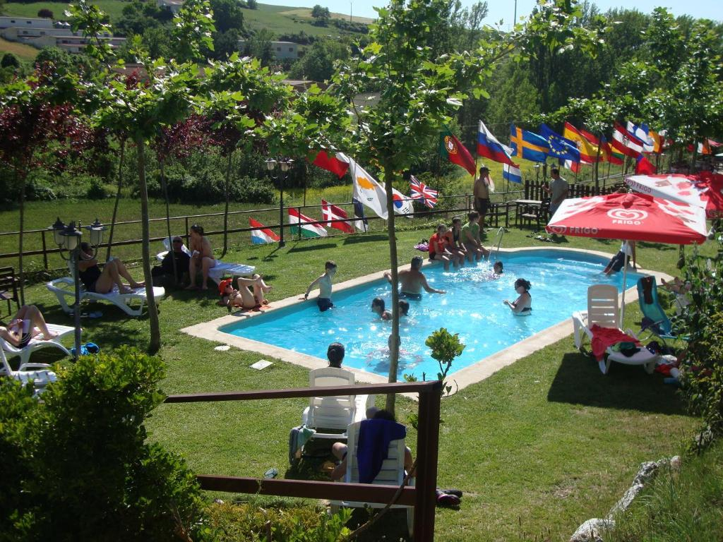 The swimming pool at or near Albergue de Peregrinos A Santiago
