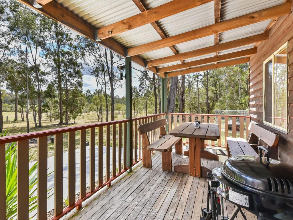 A porch or other outdoor area at Wallaby Cottage - cute Accom in bushland setting