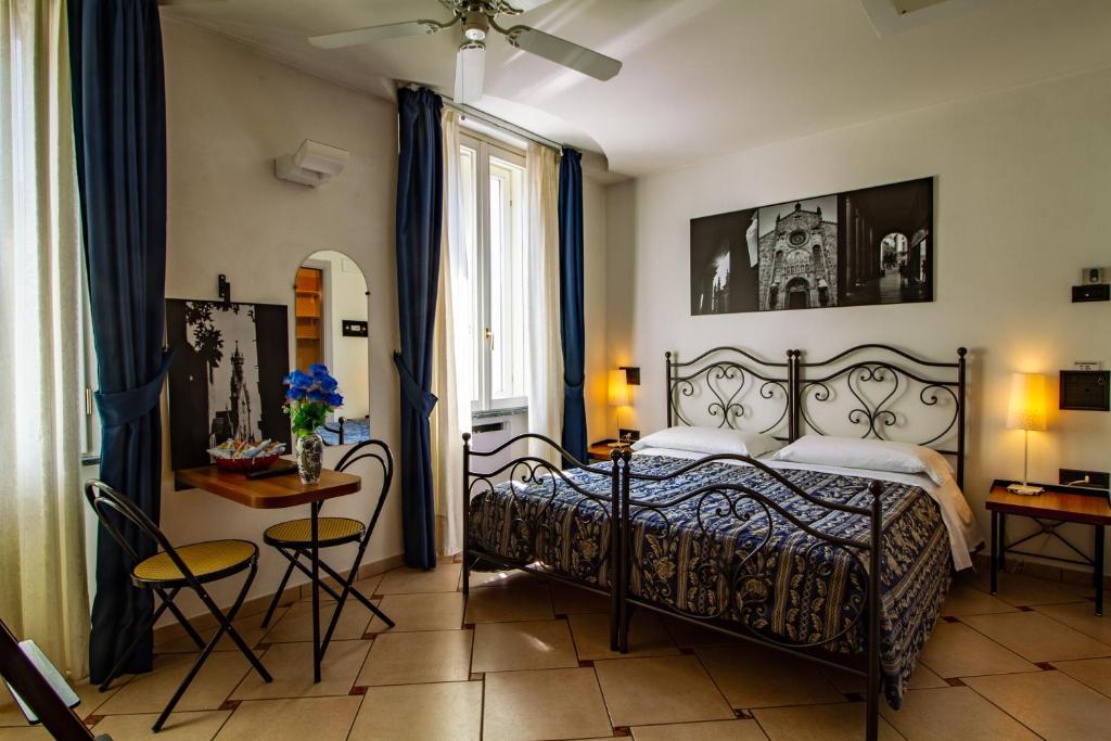 Ein Zimmer in der Unterkunft In Riva Al Lago