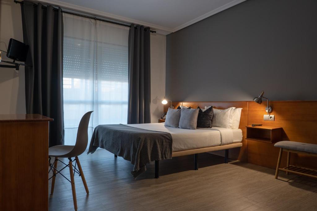 Una habitación en Hotel Carlos 96