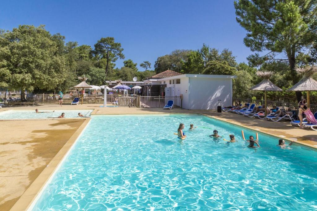 The swimming pool at or near Domaine Résidentiel de Plein Air Odalys Monplaisir