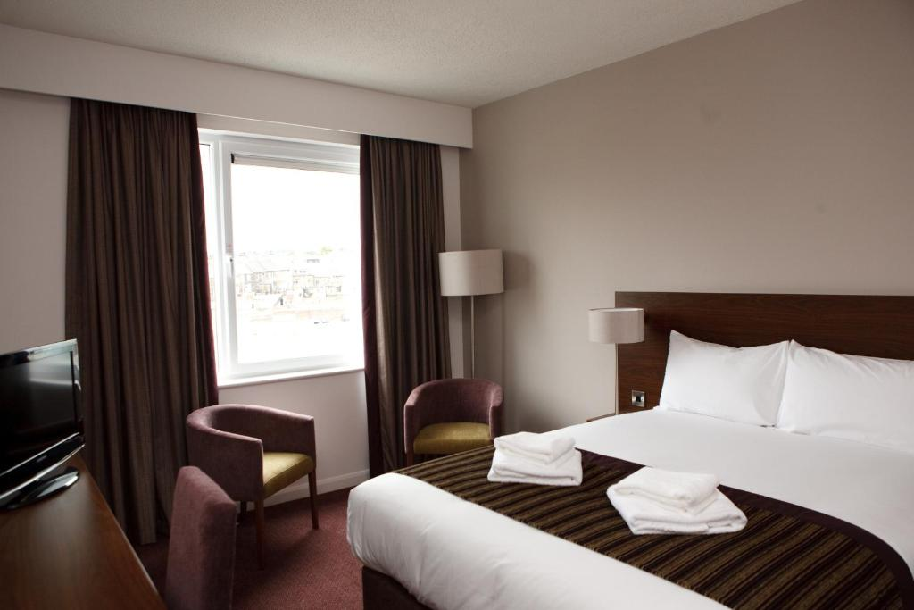 A bed or beds in a room at Jurys Inn Bradford