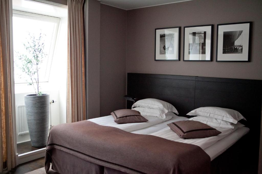Säng eller sängar i ett rum på Hotel Villan