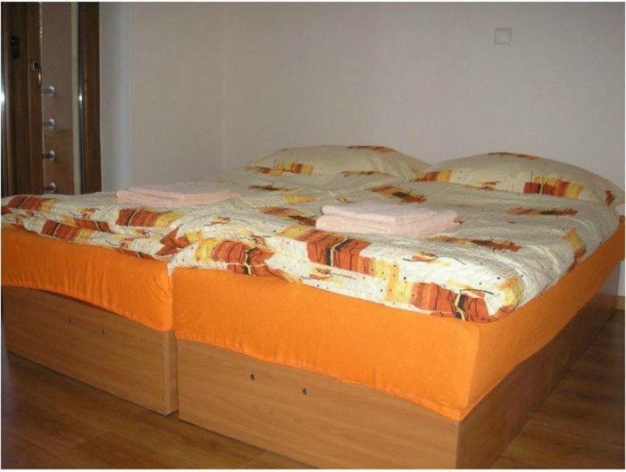 Postel nebo postele na pokoji v ubytování Vila Daiva