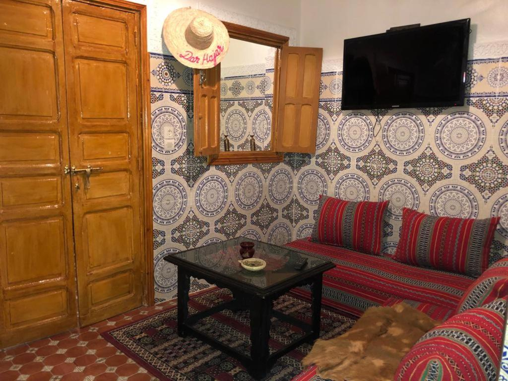 The lounge or bar area at Dar HAJAR