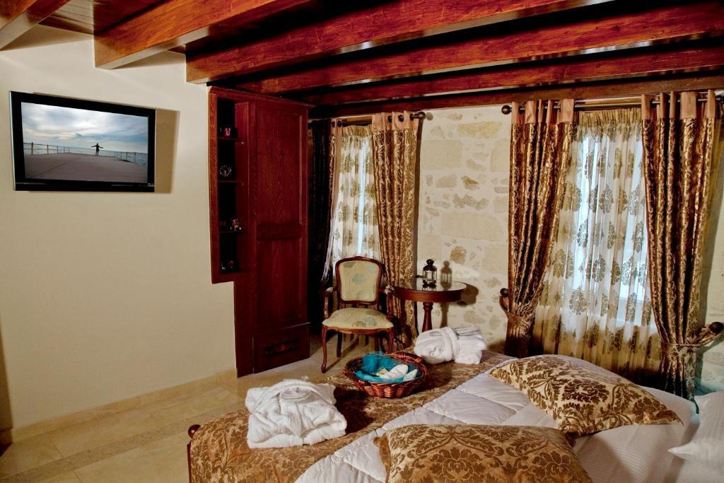 Кровать или кровати в номере Antica Dimora Suites