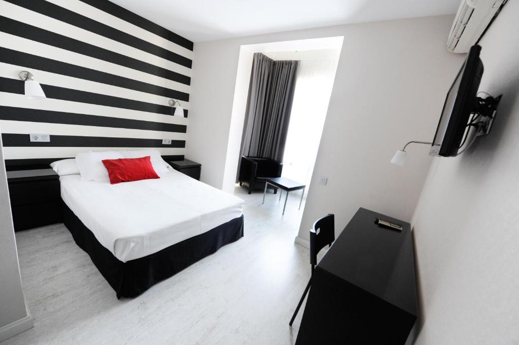 Cama o camas de una habitación en Hotel Domus