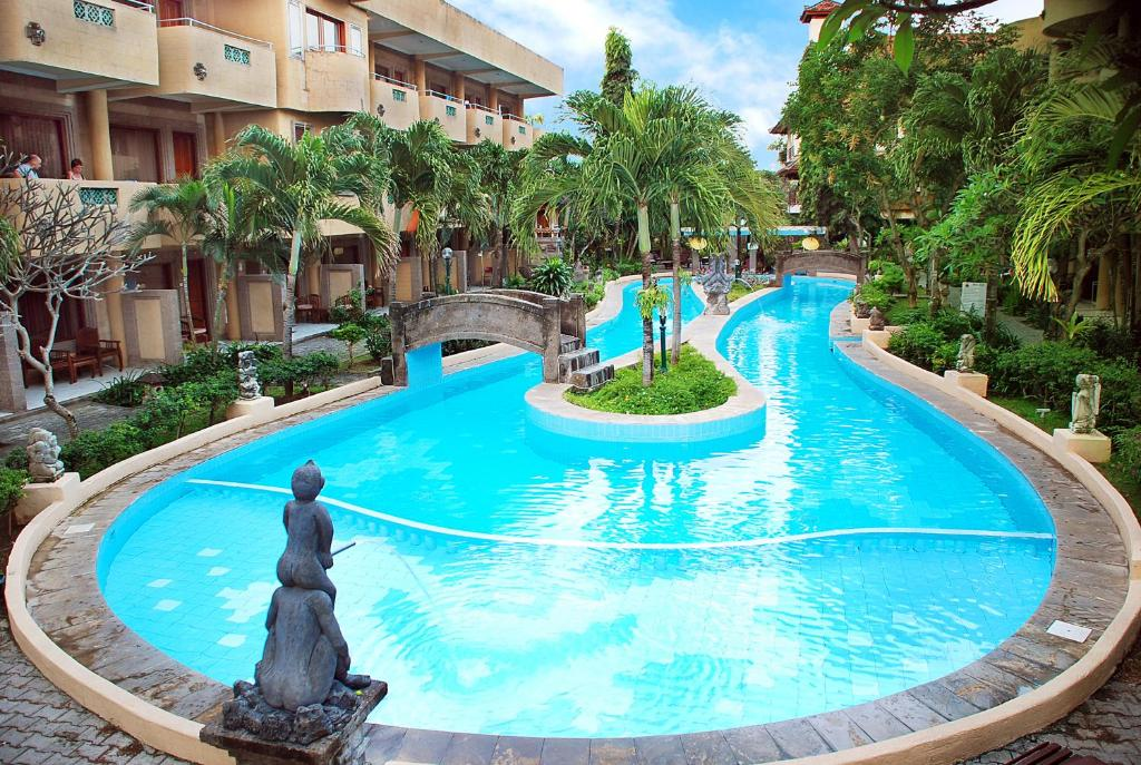 The swimming pool at or near Melasti Beach Resort & Spa Legian