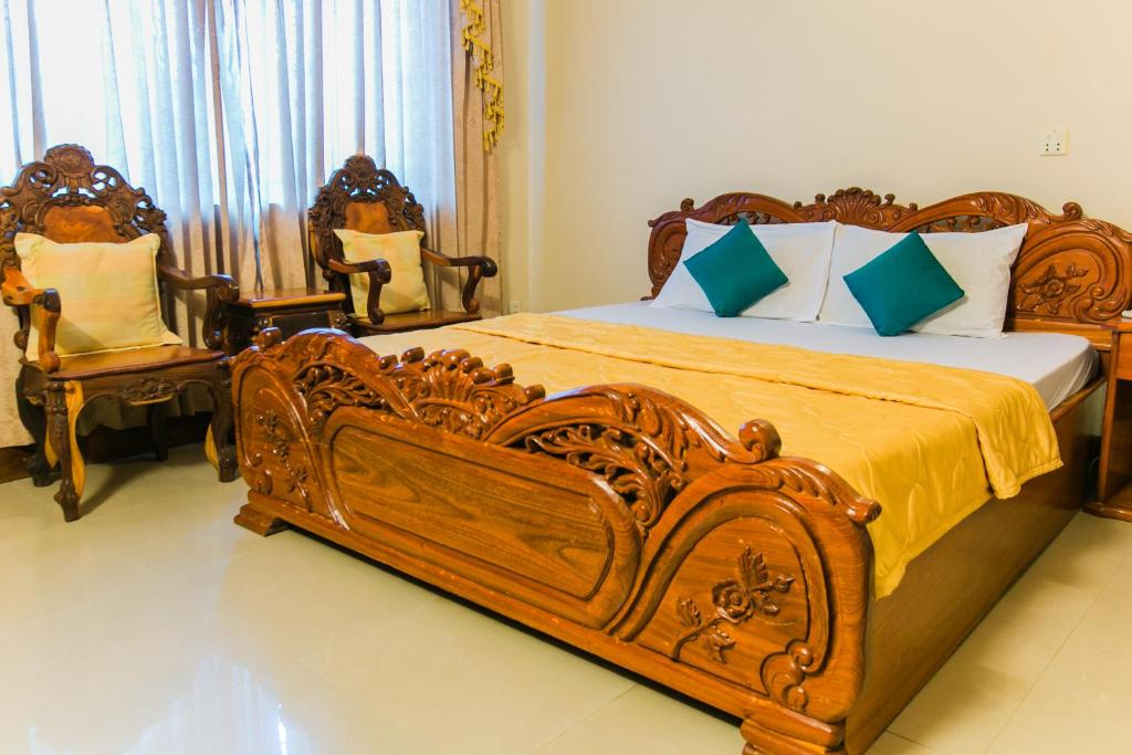 A bed or beds in a room at Star Hotel