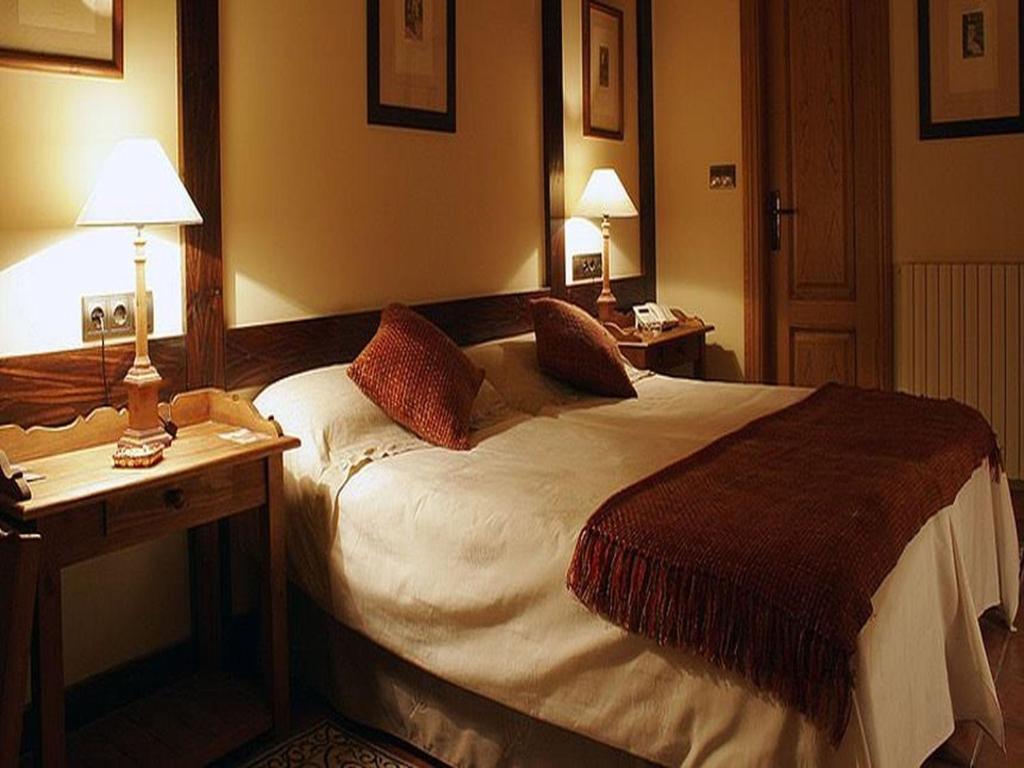 Cama o camas de una habitación en Hotel Casbas