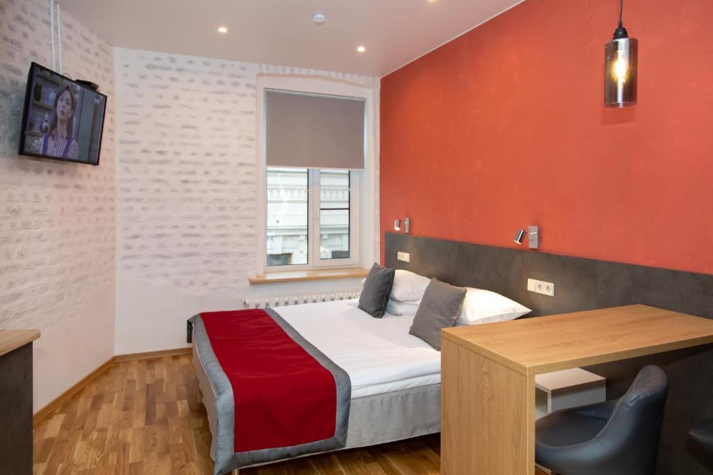 Кровать или кровати в номере Отель Атлантика
