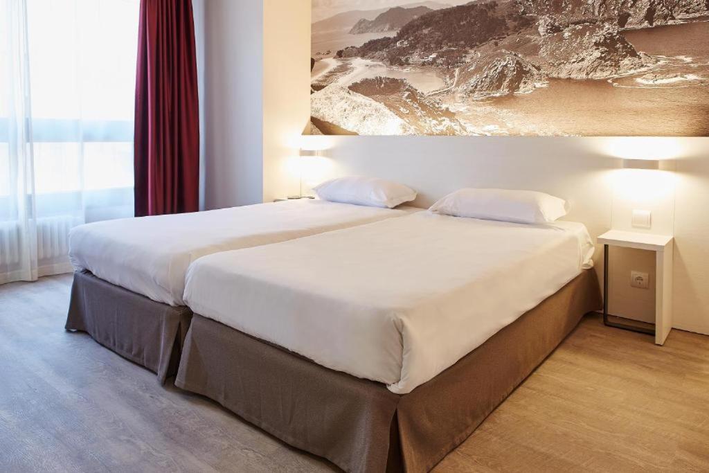 Cama o camas de una habitación en B&B Hotel Vigo