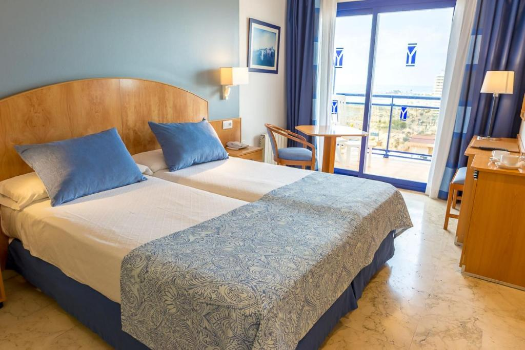 A bed or beds in a room at Hotel Yaramar - Adults Recommended