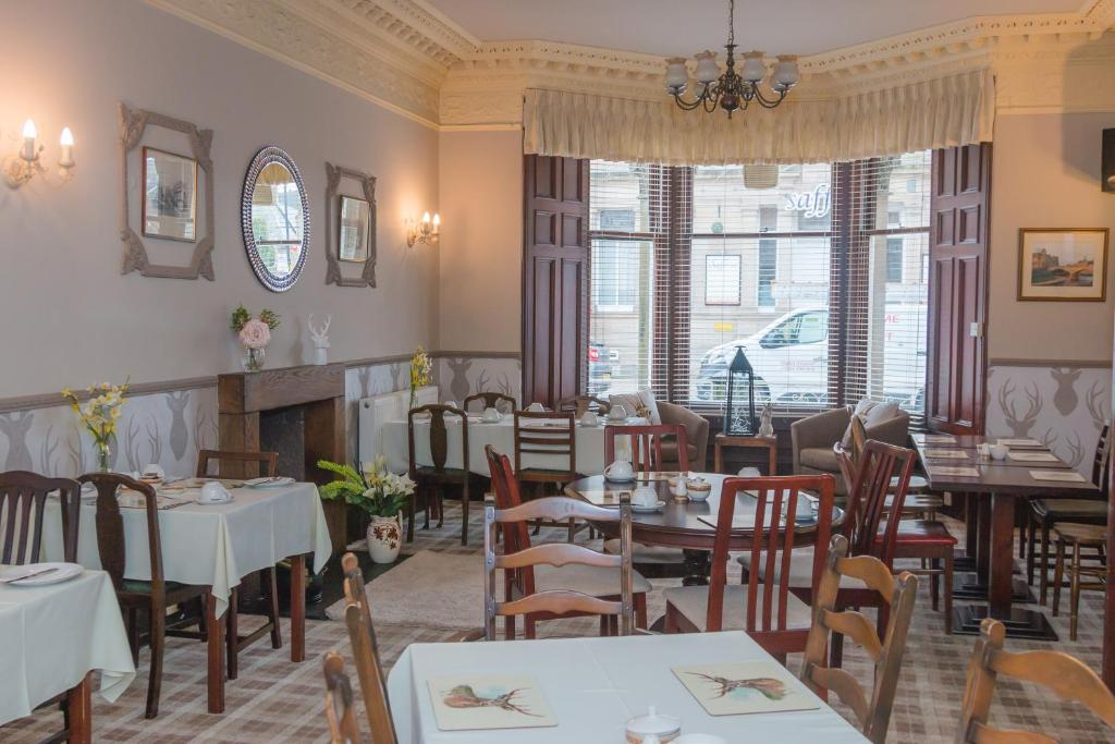 A restaurant or other place to eat at Elm House Hotel