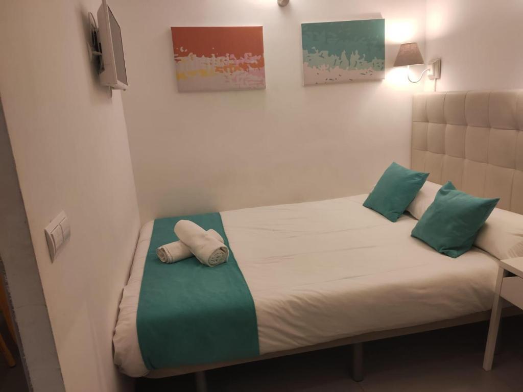 Cama o camas de una habitación en Flower Centro La Latina Plaza Mayor