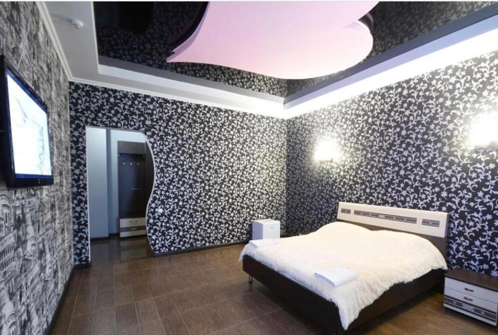 Кровать или кровати в номере Ной