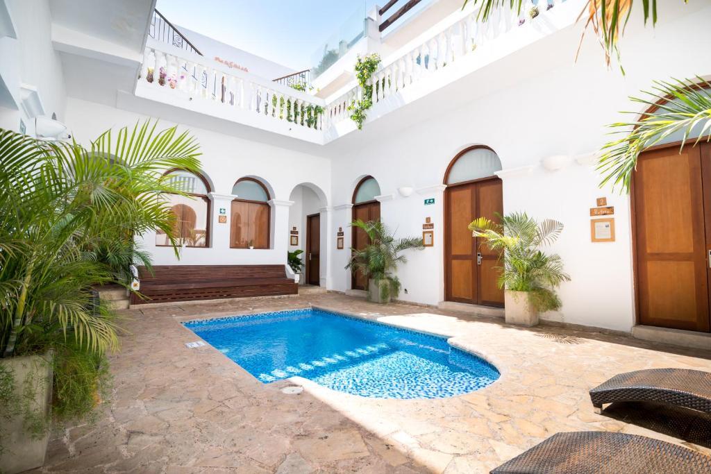 The swimming pool at or near Masaya Santa Marta