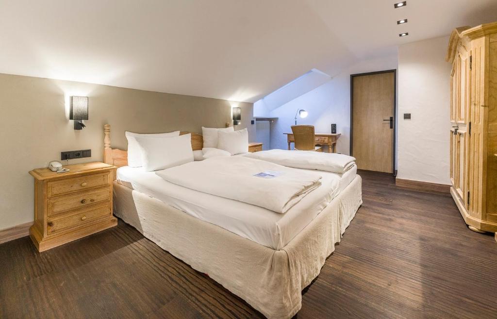 Ein Bett oder Betten in einem Zimmer der Unterkunft Staudacherhof History & Lifestyle