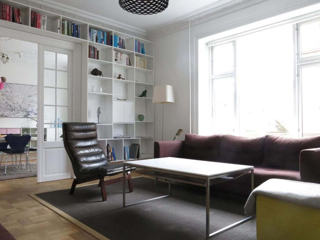 A seating area at ApartmentInCopenhagen Apartment 220
