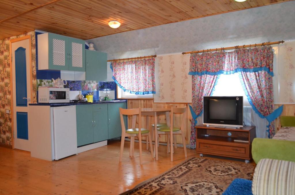A kitchen or kitchenette at Cottages On Gdantsevskaya Street